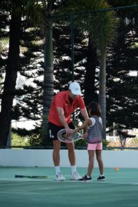 Coach Andrew working with a young junior.